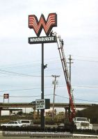 Servicing 80' tall Whataburger Sign in Red Oak, Texas